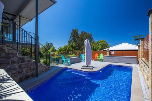 The swimming pool at or near Mollymook Apartment on Golf