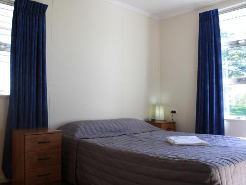 A bed or beds in a room at Lake Monduran Holiday Park