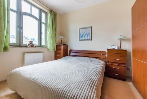 Łóżko lub łóżka w pokoju w obiekcie MW Apartamenty - MONTE CASSINO