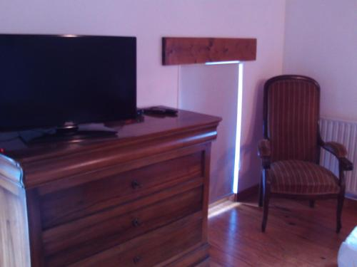 A television and/or entertainment center at Ferme auberge briassou