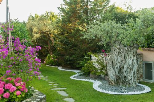 A garden outside Nikoleta Luxury Villa