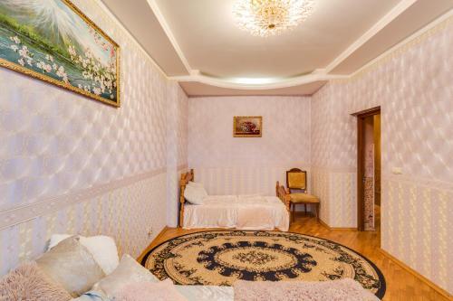 Кровать или кровати в номере Апартаменты Делюкс в Перово
