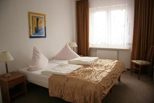 Łóżko lub łóżka w pokoju w obiekcie Relax Inn Health & Spa