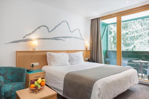 Postel nebo postele na pokoji v ubytování Alpine Club By Diamond Resorts