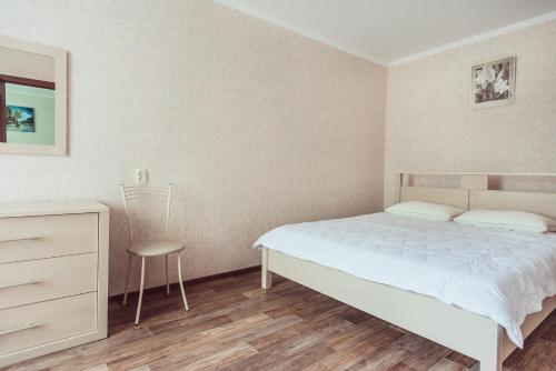 Кровать или кровати в номере Bulvar Lenina 20