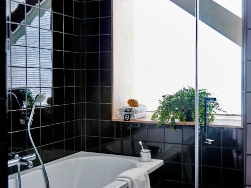 A bathroom at Q-Factory Hotel
