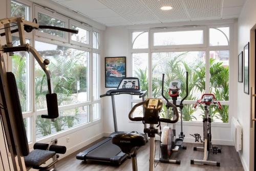 The fitness center and/or fitness facilities at Villa Diana
