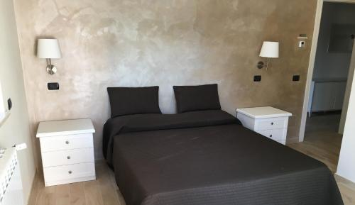 A bed or beds in a room at Villa Artemis
