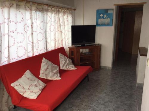 Télévision ou salle de divertissement dans l'établissement Tranquilo y Acogedor Apartamento