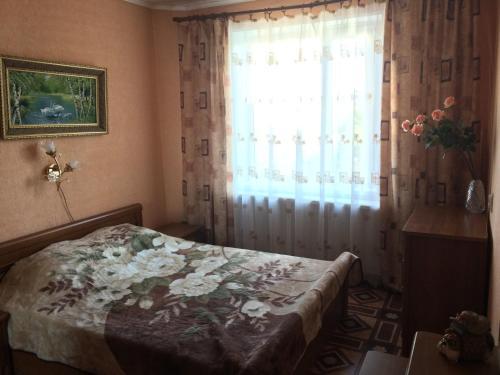 Кровать или кровати в номере Zvezdnaya