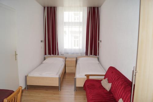 Кровать или кровати в номере Hotel Garni Wilder Mann