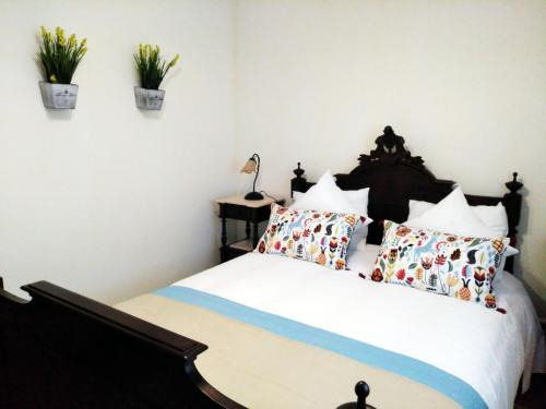 A bed or beds in a room at Casa Da Noquinhas