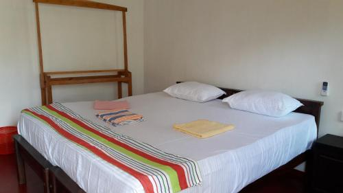 A bed or beds in a room at The Bavarian Resort