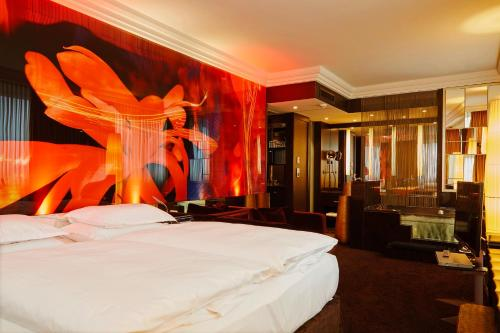 A bed or beds in a room at Savoy Hotel