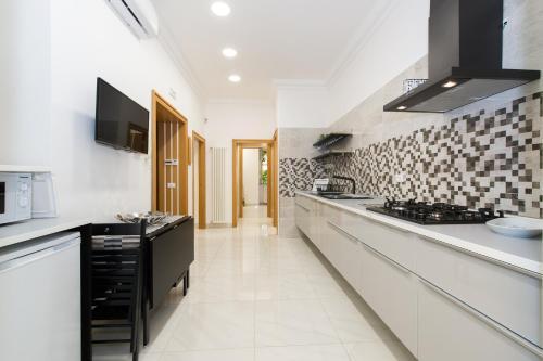 A kitchen or kitchenette at Ottaviano Exclusive Maison