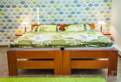 Postel nebo postele na pokoji v ubytování Vila Magnolie