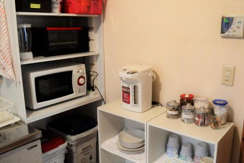 A kitchen or kitchenette at Peace house Abeno