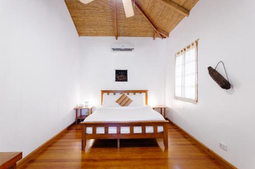 A bed or beds in a room at The Strand Boracay