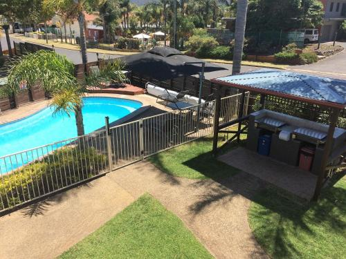 A view of the pool at Beachfront Apartments or nearby