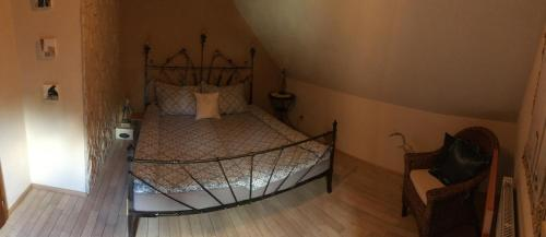 A bed or beds in a room at Penzion Nebeski