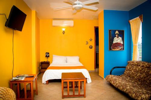 A bed or beds in a room at Hotel Maya Vista