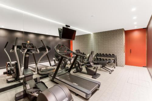 The fitness center and/or fitness facilities at Room Mate Giulia