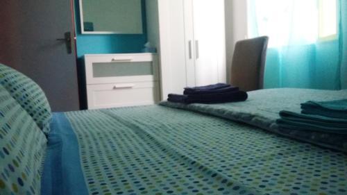 Letto o letti in una camera di Casa Roby 120 mt Beach