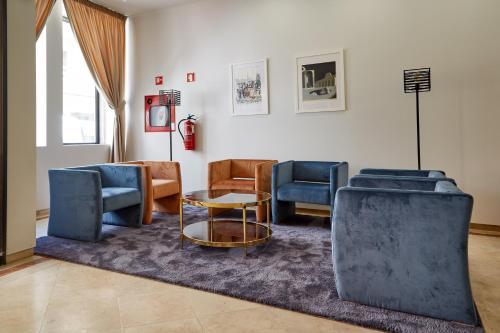 Een zitgedeelte bij Porto Domus Hotel