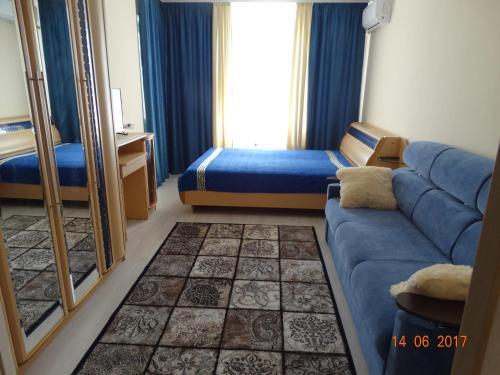 Кровать или кровати в номере Апартаменты Ленинский проспект
