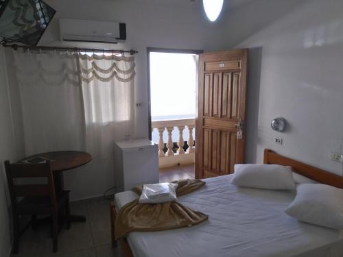 A bed or beds in a room at Hotel Garrafão - Sua Casa em Boituva