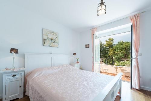 A bed or beds in a room at Villa Frane