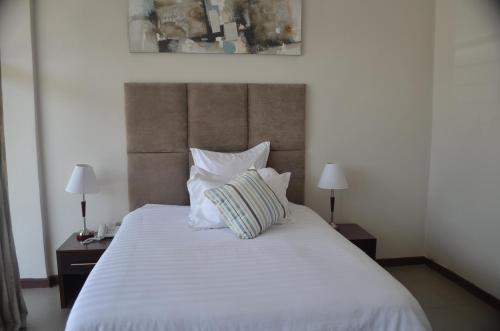 A bed or beds in a room at Pamo Hotel and Restaurants