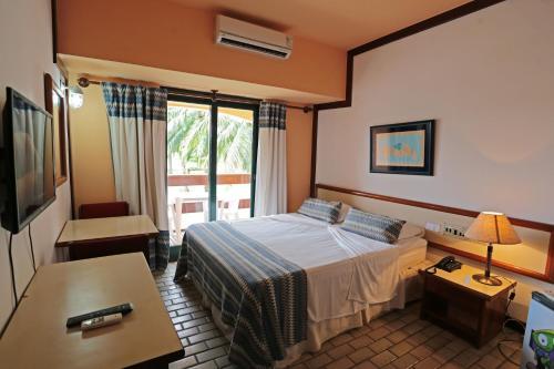 Кровать или кровати в номере Portal Rio Una