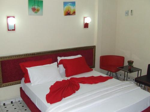 A bed or beds in a room at Hotel Relax