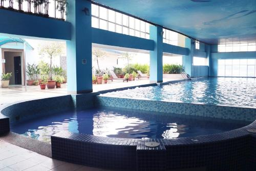 The swimming pool at or near Grand Borneo Hotel