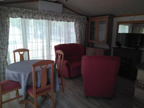 A seating area at Camping Fuentes Blancas