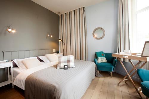 Un ou plusieurs lits dans un hébergement de l'établissement Hotel Apostrophe - De Haan