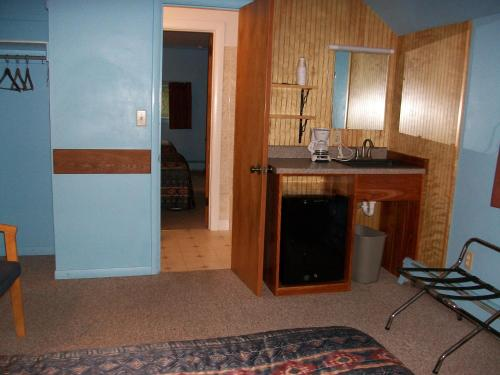 A kitchen or kitchenette at Mohican Motel