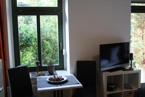 A television and/or entertainment centre at Silentio Schletterstrasse