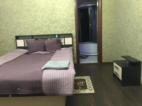 Кровать или кровати в номере Курумоч-Отель-Кафе