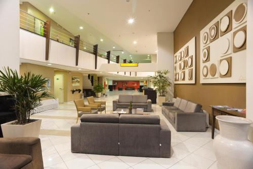 The lobby or reception area at Tri Hotel Executive Caxias