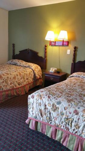 A bed or beds in a room at Capitol Inn and Suites