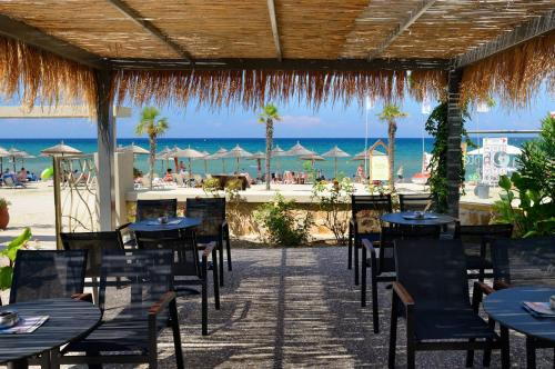 A restaurant or other place to eat at Atrium Hotel Thassos
