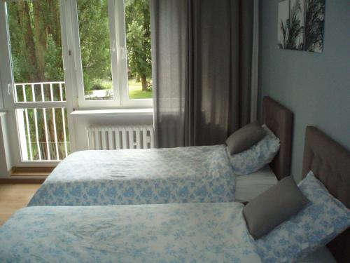 A bed or beds in a room at Budget Stay