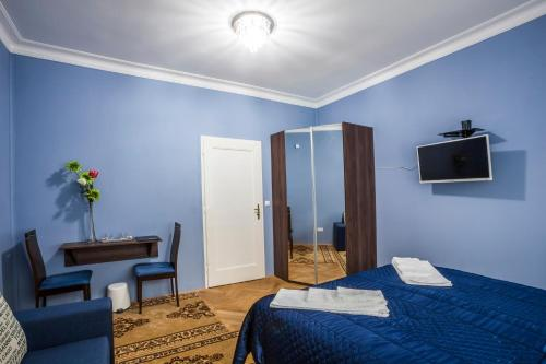 A television and/or entertainment center at Luxury Air-Conditioned rooms in Old Town Bratislava