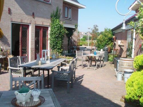 Restaurant ou autre lieu de restauration dans l'établissement Logement Brocante