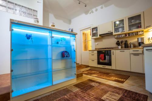 A kitchen or kitchenette at Luxury Air-Conditioned rooms in Old Town Bratislava