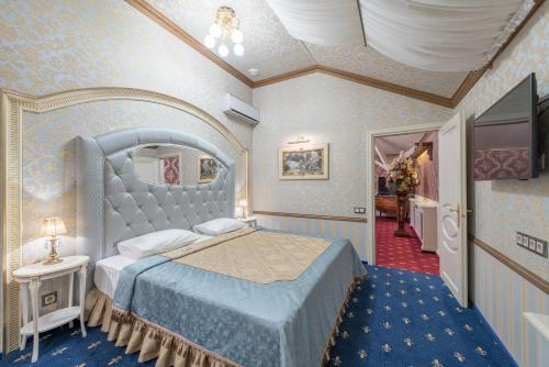 Кровать или кровати в номере Бутик-Отель Тургеневъ