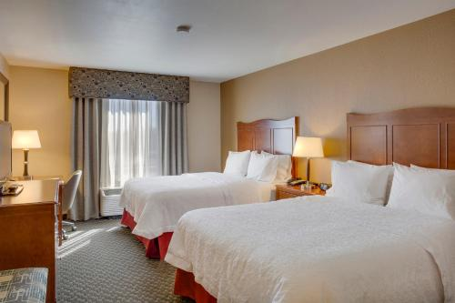 A bed or beds in a room at Hampton Inn Chickasha