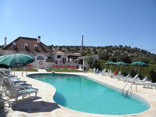 The swimming pool at or near Hotel Jardim